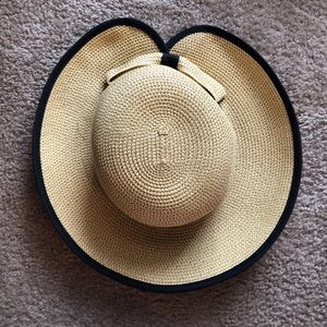 Straw hat with black bow—Peter Beaton Look-a-like